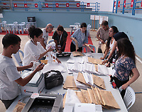 Workers of Tunisia's Independent High Authority for Elections (ISIE) dispatch ballot boxes to polling stations in Tunis on September 14, 2019, ahead of tomorrow's presidential election.
