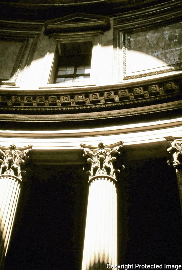 Interior detail view of the Pantheon showing Corinthian columns and rotunda wall.