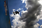 Professional skateboard Neil Hendrix gets some lofty air above the Van's Warped Tour half pipe during the annual sports & music show held at Old Bridge Twp. Raceway Park on Aug. 11, 2004<br /> (MARK R. SULLIVAN)