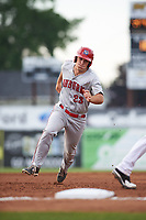 Auburn Doubledays pinch runner Chance Shepard (23) rounds third base to score a run on a single by Omar Meregildo (not shown) in the top of the fourth inning during a game against the Batavia Muckdogs on July 6, 2017 at Dwyer Stadium in Batavia, New York.  Auburn defeated Batavia 4-3.  (Mike Janes/Four Seam Images)