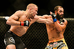 Las Vegas, NV - November 16, 2013, 2013: UFC light welterweights, Georges St Pierre (black trunks) and Johny Hendricks (yellow trunks) during their championship fight at UFC 167 at The MGM Grand Garden Arena inside the MGM Resort and Casino in Las Vegas, NV. (Al Powers for ESPN)