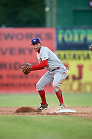 Auburn Doubledays shortstop Andres Martinez (5) turns a double play during a game against the Batavia Muckdogs on June 19, 2017 at Dwyer Stadium in Batavia, New York.  Batavia defeated Auburn 8-2 in both teams opening game of the season.  (Mike Janes/Four Seam Images)