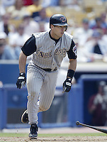 Greg Colbrunn of the Arizona Diamondbacks bats during a 2002 MLB season game against the Los Angeles Dodgers at Dodger Stadium, in Los Angeles, California. (Larry Goren/Four Seam Images)