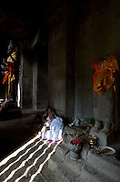Buddhist Nuns,Priest in the corridor of the Angkor Wat Temple complex, Siam Reap, Cambodia