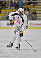 28 January 2012: University of Vermont Catamount forward Matt White, a Sophomore from McMurray, PA, takes a shot against the Northeastern University Huskies at Gutterson Fieldhouse in Burlington, Vermont. The Catamounts, dressed in their Breast Cancer Awareness jerseys, fell to the Huskies 4-2 in the second game of their 2-game Hockey East weekend series. Mandatory Credit: Ed Wolfstein Photo