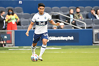 KANSAS CITY, KS - MAY 16: Michael Baldisimo #55 Vancouver Whitecaps with the ball during a game between Vancouver Whitecaps and Sporting Kansas City at Children's Mercy Park on May 16, 2021 in Kansas City, Kansas.
