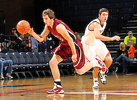 Nov 6, 2010; Charlottesville, VA, USA; Roanoke College f Joey Leech (42) steals the ball from Virginia Cavaliers g Billy Baron (15) Saturday afternoon in exhibition action at John Paul Jones Arena. The Virginia men's basketball team recorded an 82-50 victory over Roanoke College.