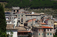 Lenola: The old small town is located just outside the Monti Aurunci Natural Park, towards North, more in the inland with respect to Fondi. Here a view from below of the historical center, in which the old buildings appear holded onto the hill side. This is a slight enlargement of a part of the original image.