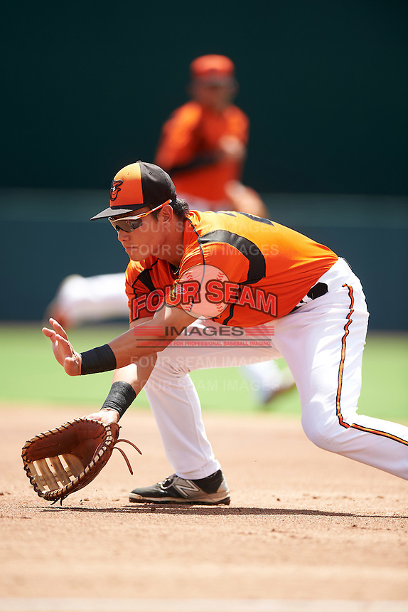 GCL Orioles first baseman Gui Yuan Xu (21) fields a ground ball during a game against the GCL Red Sox on August 16, 2016 at the Ed Smith Stadium in Sarasota, Florida.  GCL Red Sox defeated GCL Orioles 2-0.  (Mike Janes/Four Seam Images)