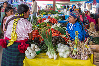 Tlacolula; Oaxaca; Mexico.  Tlacolula Market.  Zapotec Indian Vegetable Vendor.