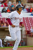 Wisconsin Timber Rattlers outfielder Trent Clark (27) jogs to first base during a Midwest League game against the Clinton LumberKings on May 9th, 2016 at Fox Cities Stadium in Appleton, Wisconsin.  Clinton defeated Wisconsin 6-3. (Brad Krause/Four Seam Images)