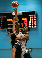 Justin Gordon of Newcastle Eagles shoots from distance during the BBL Championship match between Surrey Scorchers and Newcastle Eagles at Surrey Sports Park, Guildford, England on 20 March 2021. Photo by Liam McAvoy.