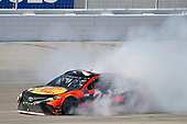 2017 Monster Energy NASCAR Cup Series - Kobalt 400<br /> Las Vegas Motor Speedway - Las Vegas, NV USA<br /> Sunday 12 March 2017<br /> Martin Truex Jr, Bass Pro Shops/TRACKER BOATS Toyota Camry celebrates his win with a burnout<br /> World Copyright: Nigel Kinrade/LAT Images<br /> ref: Digital Image 17LAS1nk07759