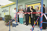 San Diego Councilmember for District 2, Kevin Faulconer cuts a ribbon stands with the staff of the new  Beach Area Women's Health Center in Mission Beach San Diego, as he cuts a ribbon to celebrate the center's opening December 6  2007.