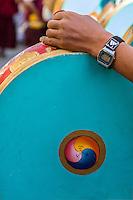 Nepal, Kathmandu, Swayambhunath.  Tibetan Buddhist Ceremonial Drum with Symbol of Joy (Gankyil) Decoration.