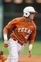Texas Longhorns first baseman Kacy Clemens #42 sprints around third base during the NCAA baseball game against the Houston Cougars on March 1, 2014 during the Houston College Classic at Minute Maid Park in Houston, Texas. The Longhorns defeated the Cougars 3-2. (Andrew Woolley/Four Seam Images)