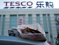 A dead turtle after being sold  and killed in Tesco, in the Fengtai area of Beijing.  Live turtles are sold and often killed on the premises of the shop.  The turtles cost 48 RMB (4.88 UK pounds) for a kilo. The turtle in the basket cost 163 RMB (16.59 UK pounds).<br /> <br /> Photo by Sinopix