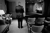 Salisbury, Maryland.USA.March 19, 2007..Rachel Guy-Latham, 22 morns her husband Sgt. Thomas Lee Latham, 23, of Delmar, Md., in the funeral home after viewing his body for the first time. She accompanied by a member of the military, (one on Tommy's instructors)...Sgt. Thomas Lee died March 11 in Baghdad, Iraq, of wounds sustained when an improvised explosive device detonated near his Humvee. He was assigned to the 2nd Battalion, 14th Infantry Regiment, 2nd Brigade Combat Team, 10th Mountain Division, Fort Drum, N.Y.