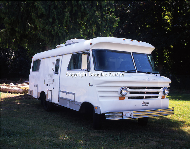 """This 26-foot 1972 Krager motorhome was built by the Krager Company in Winona, Minnesota. Winona's other claim to fame is that it is the birthplace of actress Winona Ryder. Like Ryder, whose family moved to Petaluma, California, when she was a small child, the Krager motorhome's tenure in Winona was very brief. At most, there were a few dozen units manufactured under the name Krager Kustom Koach, but despite their limited numbers they are very easy to spot thanks to their unusual front end. The modestly proportioned vehicle was powered by a generous 392 V8 International """"Cornbinder"""" engine. The Krager's short wheelbase, high center, and noncorrosive fiberglass body made it more adaptable to backcountry roads than other bulky motorhomes. These qualities were meant to appeal to outdoorsmen and hunters. The unit was fully self-contained and was equipped with sleeping accommodations for four adults in bunk beds, rather than the standard two double beds. This lodging style definitely appealed to manly outdoorsmen. The Krager is owned by James Weaver Jr. Photographed at the Deming Log Show Grounds, Bellingham, Washington."""