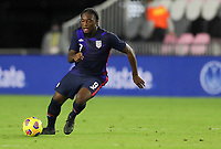 FORT LAUDERDALE, FL - DECEMBER 09: Ayo Akinola #9 of the United States moves with the ball during a game between El Salvador and USMNT at Inter Miami CF Stadium on December 09, 2020 in Fort Lauderdale, Florida.