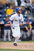 Evan Dougherty (27) of the Duke Blue Devils runs towards first base during the game against the California Golden Bears at Durham Bulls Athletic Park on February 20, 2016 in Durham, North Carolina.  The Blue Devils defeated the Golden Bears 6-5 in 10 innings.  (Brian Westerholt/Four Seam Images)