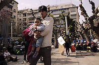 Pictured: A father carries his young child at Victoria Square, Athens, Greece Monday 29 February 2016<br /> Re: Hundreds of migrants have been living in Victoria Square in central Athens Greece.