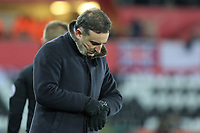 Swansea manager Carlos Carvalhal checks the time on his watch during The Emirates FA Cup Fifth Round Replay match between Swansea City and Sheffield Wednesday at the Liberty Stadium, Swansea, Wales, UK. Tuesday 27 February 2018