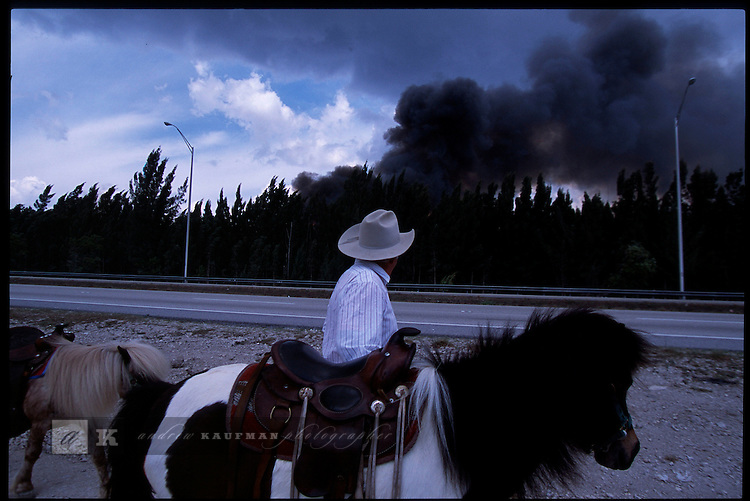 2-28-01.A local pony ride operator is forced to move during wildfires off of Miami's Calle Ocho.