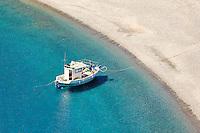 A fishing boat in Agios Minas beach of Karpathos, Greece