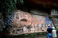 Tourists at stone carvings of Baobing Buddha Pilgrims at Dazu in China
