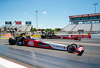 Jul 12, 2020; Clermont, Indiana, USA; NHRA top fuel driver Doug Kalitta (near) races alongside Billy Torrence in the final round of the E3 Spark Plugs Nationals at Lucas Oil Raceway. This is the first race back for NHRA since the start of the COVID-19 global pandemic. Mandatory Credit: Mark J. Rebilas-USA TODAY Sports