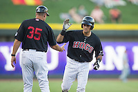 Nick Basto (17) of the Winston-Salem Dash slaps hands with third base coach Joel Skinner (35) after hitting a 2-run home run against the Salem Red Sox at BB&T Ballpark on June 16, 2016 in Winston-Salem, North Carolina.  The Dash defeated the Red Sox 7-1.  (Brian Westerholt/Four Seam Images)