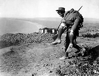 The irrepressible Australians at Anzac.  An Australian bringing in a wounded comrade to hospital.  Dardanelles Campaign, ca.  1915.  British Official. (War Dept.)<br /> EXACT DATE SHOT UNKNOWN<br /> NARA FILE #:  165-BO-562<br /> WAR & CONFLICT BOOK #:  664