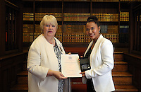 Marlina Coschignano (R) receives her certificate at the Citizenship Ceremony at Carmarthen Register Office, Carmarthenshire, Wales, UK. Monday 22 August 2016