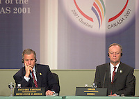 April 22,  2001, Quebecl, Quebec, Canada<br /> <br /> George W, Bush, United States of Americas President (R) and Jean Chretien, Canada's Prime Minister (L) listen to a journalist's question at the closing press conference of the Summit of the Americas , April 22, 2001 in Quebec City, CANADA.<br /> <br /> Both leader agreed to meet before the upcoming G-8 meeting this spring in Alberta, Canada.<br /> <br /> Mandatory Credit: Photo by Pierre Roussel- Images Distribution. (©) Copyright 2001 by Pierre Roussel <br /> ON SPEC<br /> NOTE l Nikon D-1 jpeg opened with Qimage icc profile, saved in Adobe 1998 RGB.