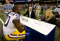 Michael Brockers of LSU talks with ESPN reporter Holly Rowes during BCS Media Day at Mercedes-Benz Superdome in New Orleans, Louisiana on January 6th, 2012.
