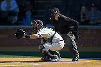 Wake Forest Demon Deacons catcher Ben Breazeale (9) sets a target as home plate umpire Drew Maher looks on during the game against the Richmond Spiders at David F. Couch Ballpark on March 6, 2016 in Winston-Salem, North Carolina.  The Demon Deacons defeated the Spiders 17-4.  (Brian Westerholt/Four Seam Images)