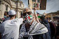 """Rome, Italy. 15th May, 2021. Today, thousands of Pro-Palestinian activists and members of the public gathered in Piazza dell'Esquilino to mark the 73rd Anniversary of """"Nakba"""" («The 1948 Palestinian exodus, also known as the Nakba literally """"disaster"""", """"catastrophe"""", or """"cataclysm"""", occurred when more than 700,000 Palestinian Arabs fled or were expelled from their homes, during the 1948 Palestine war […]», 1.); to show support and solidarity to the Palestinian People; to protest against the crisis between Palestinian people and the Israeli armed forces which began on the 6th of May 2021 with the decision of the Israeli Supreme Court to evict four Palestinian families from the East Jerusalem neighborhood of Sheikh Jarrah, part of the Palestinian Territories under international law. The protests quickly escalated in an asymmetric conflict between Israeli Air Forces airstrikes and Hamas' rockets fired from the Gaza Strip which killed at least 190 Palestinians, including 41 children, and 10 Israelis, including 2 children. The demonstration in Rome - organised by the Palestinian Community of Rome and Lazio (2.) - culminated with a peaceful march which ended outside the Colosseum, while Similar demonstrations were held in the major cities across the globe.<br /> <br /> Footnotes & Links:<br /> 1. (Source Wikipedia.org. ENG) https://en.wikipedia.org/wiki/1948_Palestinian_exodus<br /> 2. https://www.facebook.com/groups/sandoga/<br /> Other Organizations involved: http://www.assopacepalestina.org/ & http://bit.do/frfpo<br /> For Live Updates (Source, Aljazeera.com ENG): https://www.aljazeera.com/news/2021/5/16/more-deaths-gaza-israel-launches-most-intense-raids-yet"""