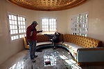 Men hang out in the home of Jelila Trabelsi, sister of Tunisian President Ben Ali's wife in Carthage suburb, Tunis, Tunisia, Jan. 16, 2011. The home was looted and vandalized after the president left the country.
