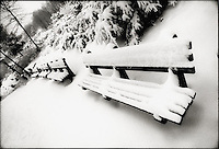 Snow covered park benches<br />