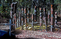 Traditional Aboriginal Pukumani - Mortuary Ceremony<br /> These poles are placed around the burial site during the ceremony. Interesting in this photo are the christian crosses.<br /> They symbolize the status and prestige of the deceased. Participants in the ceremony are painted with natural ochres in many different designs, transforming the dancers and providing protection against recognition by the spirit of the deceased.<br /> <br /> Pukumani poles are carved from ironwood and decorated with white clay, black charcoal, and yellow or red ochre mixed with water and glue. These poles are today produced either to be sold or used by the Aborigines of the Tiwi Islands in their burial rituals where the Pukumani ritual is the last and largest in a number of Tiwi rituals, performed a few months after the person has diseased.