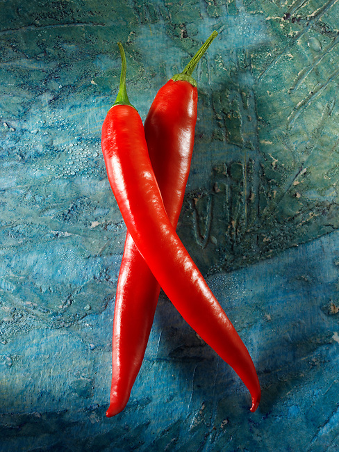 Fresh red long chiilies (chilies) photos, pictures & images
