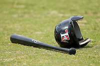 A Hickory Crawdads helmet lies next to a baseball bat at L.P. Frans Stadium June 21, 2009 in Hickory, North Carolina. (Photo by Brian Westerholt / Four Seam Images)