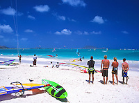 Windsurfing and Kitesurfing have become increasingly popular sports in Hawaii. Here wind and kitesurfers untilize the trade winds off Kailua Beach on Oahu's windward side to get a little air time.