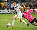 CARSON, CA - December 1, 2012: LA Galaxy forward Robbie Keane (7) is fouled by Houston goalie Tally Hall (1) during the LA Galaxy vs the Houston Dynamo for the 2012 MLS Cup at the Home Depot Center in Carson, California. Final score LA Galaxy 3, Houston Dynamo 1.