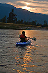 A kayaker is silhouetted by the setting sun on the Clark Fork River near Missoula, Montana