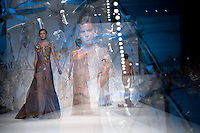 Modelle presentano le creazioni della collezione Autunno/Inverno 2013/2014 dello stilista libanese Abed Mahfouz durante la rassegna Altaroma a Roma, 9 Luglio 2013.<br /> Models wear creations of Lebanese fashion designer Abed Mahfouz Fall/Winter 2013-2014 collection during the Altaroma fashion week in Rome, 9 July 2013.<br /> UPDATE IMAGES PRESS/Virginia Farneti<br /> <br /> IN-CAMERA MULTIPLE EXPOSURE MODE WAS USED TO CREATE THE PICTURE