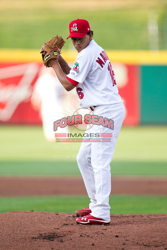 Carlos Martinez (16) of the Springfield Cardinals stands on the mound during a game against the Arkansas Travelers at Hammons Field on July 24, 2012 in Springfield, Missouri. (David Welker/Four Seam Images)
