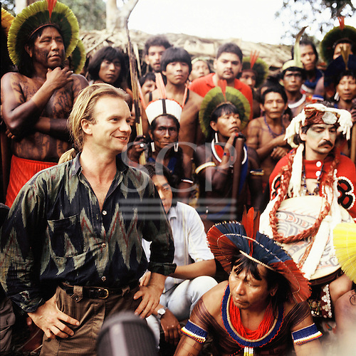 Altamira, Brazil. Sting at a protest about proposed hydroelectric dams with leaders of Amazon indigenous Indian tribes.