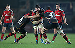 Blind-side flanker Paddy Butler of Munster Rugby is tackled by Lewis Evans and Second row Cory Hill of Newport Gwent Dragons.<br /> <br /> Guiness Pro 12<br /> Newport Gwent Dragons v Munster Rugby<br /> Rodney Parade<br /> 21.11.14<br /> ©Steve Pope-SPORTINGWALES